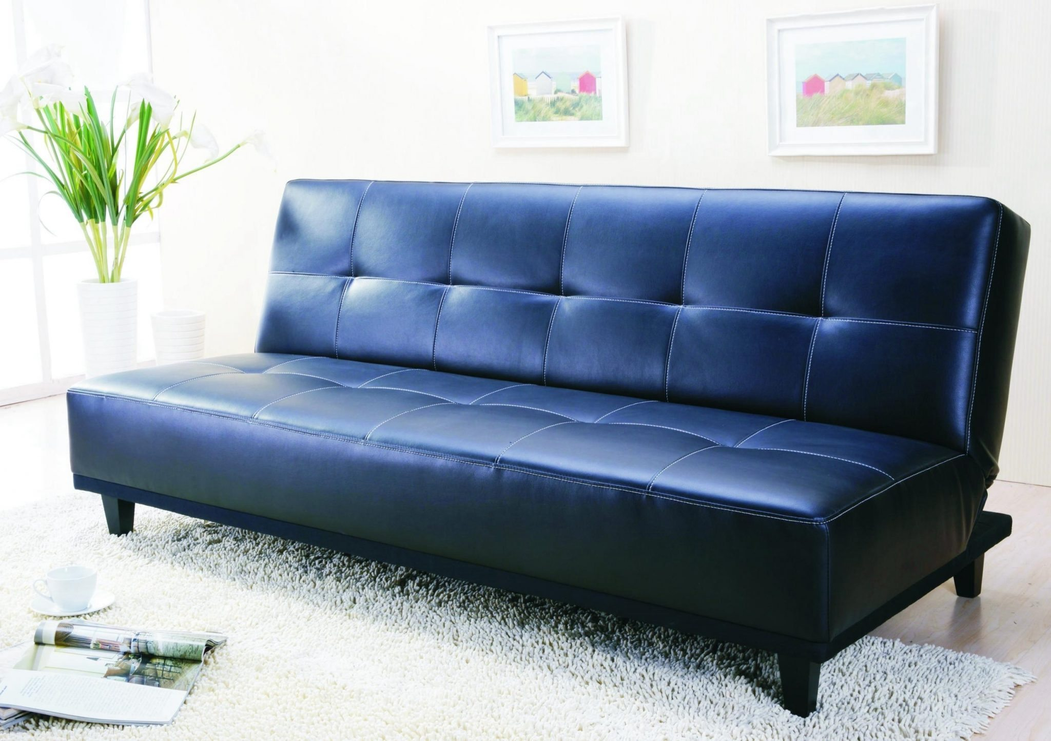 cute-light-blue-cushion-placed-on-comfortable-blue-leather-sofa-at